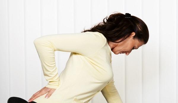 Боль в спине при беременности в одном месте